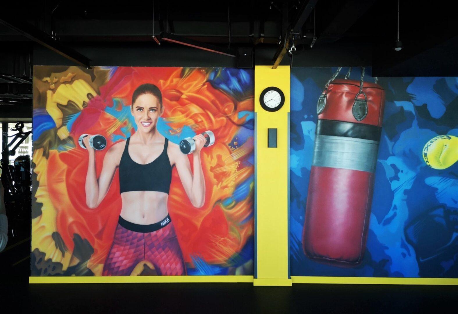 Роспись стен в спортзале офиса Епицентра гантели